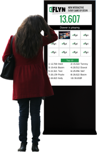 Eflyn Free Standing Multi-Touch Kiosk featuring QuickMatch App being played by a person